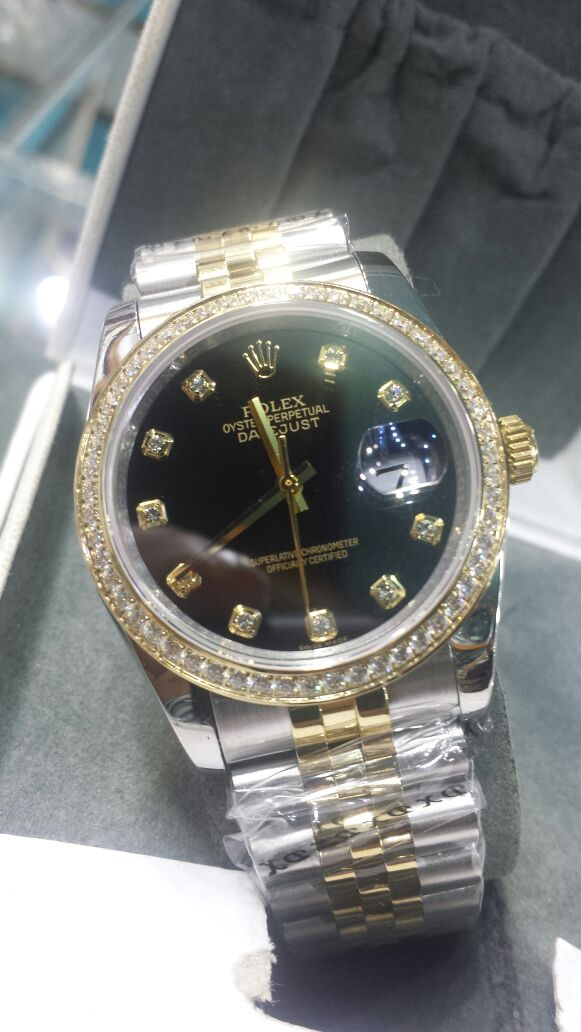 Rolex Oyster Perpetual Date Display Golden Black Watch